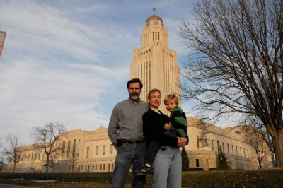 Photo: A family portrait outside the Nebraska state capitol building.