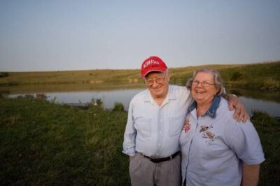 Photo: A man and woman at a Nebraska farm pond.