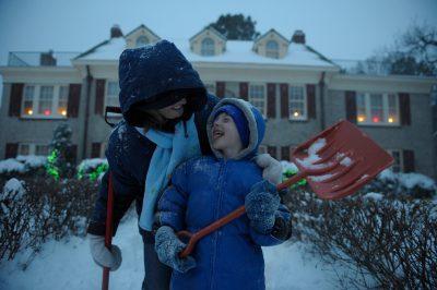 Photo: A mother and son shovel snow outside their Nebraska home.