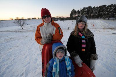 Photo: A family goes sledding at Pioneer's Park in Lincoln, Nebraska.