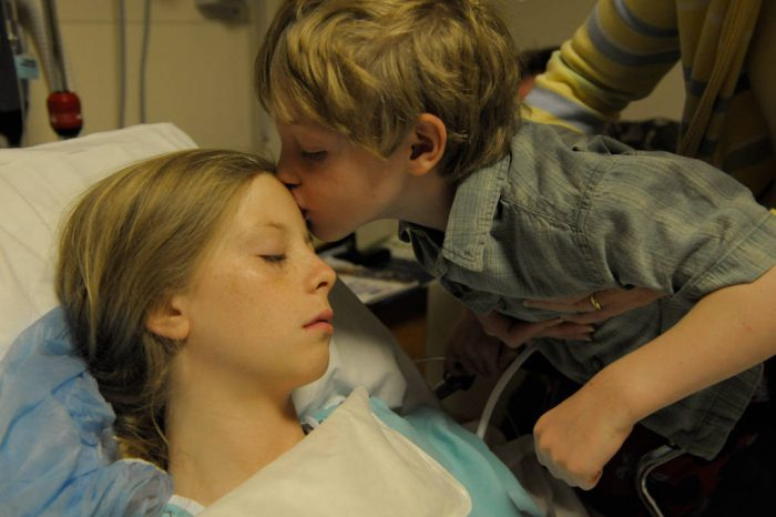 Photo: A twelve year-old girl coming out of surgery after getting her tonsils removed.