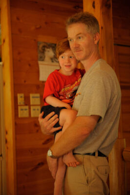 Photo: A man and his son at a home in Cross Lake, Minnesota.