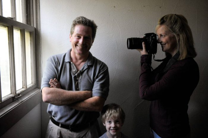 Photo: A portrait of Joel and Kathy Sartore with their son.