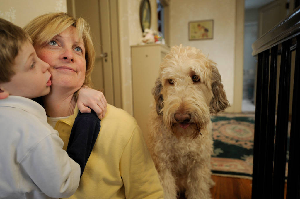 Photo: A mother and her son with the family dog in Lincoln, Nebraska.