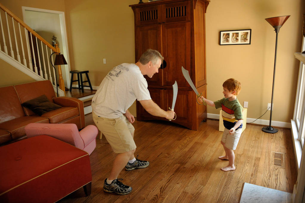 Photo: A father and his five year-old son play in their Georgia home.