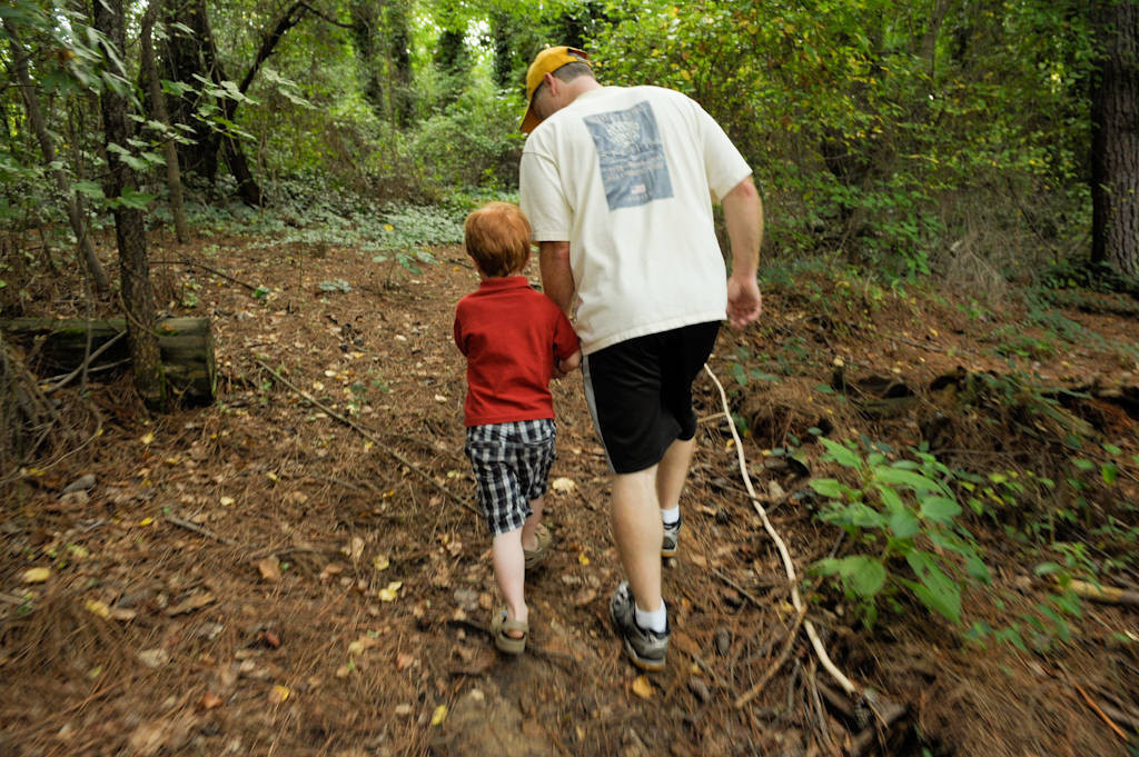 Photo: A father and his five year-old son walk along a wooded trail in Georgia.