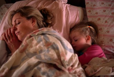Photo: A mother and daughter taking a nap.