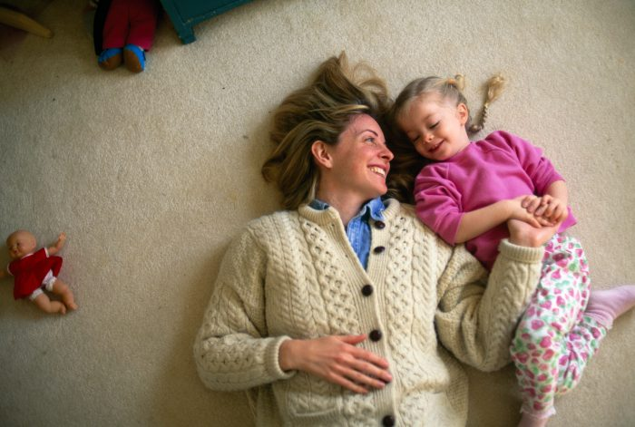 Photo: A mother and daughter playing on the floor.