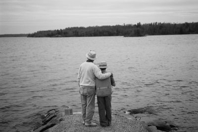 Photo: A grandfather and grandson look out over a lake in Canada.