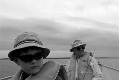 Photo: A grandfather and grandson fish on a lake in Canada.