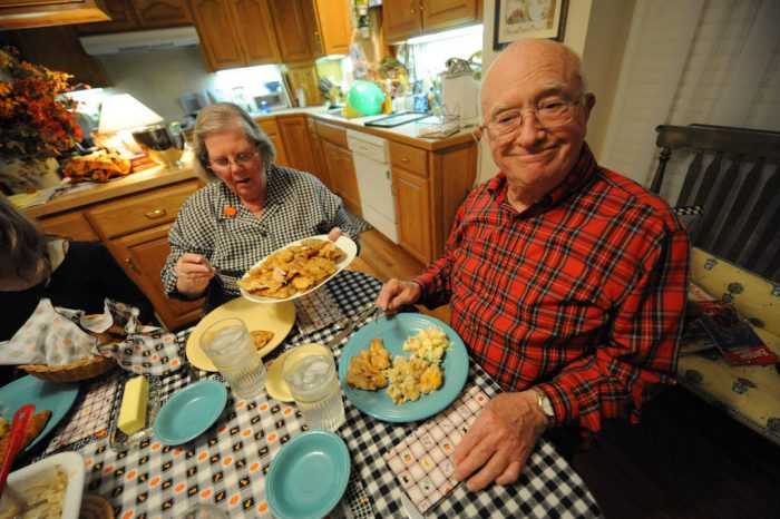 Photo: A senior man enjoys a fish dinner at his home in Nebraska.