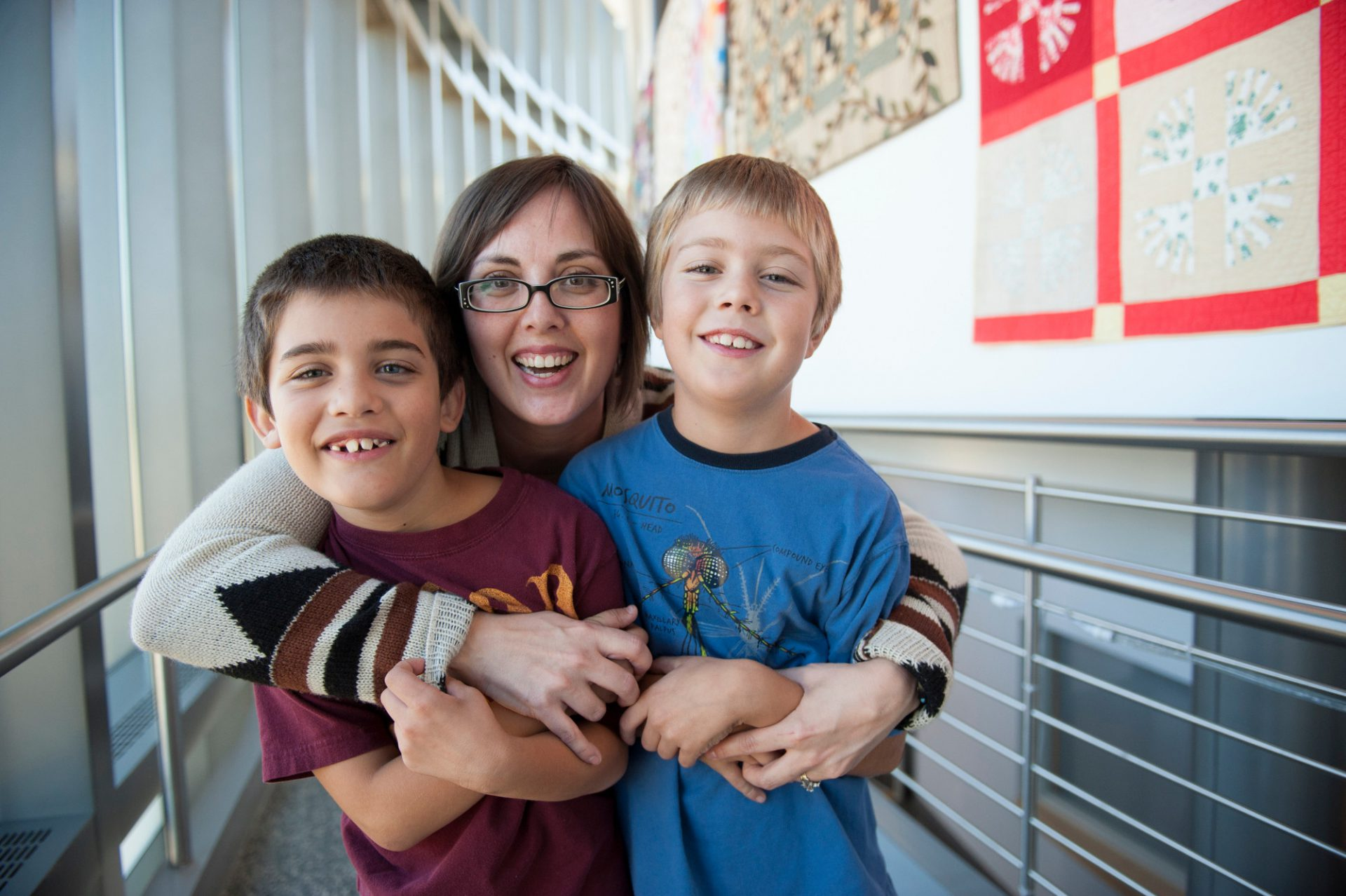 Photo: A mother and her two young sons at the International Quilt Study Center & Museum in Lincoln, Nebraska.