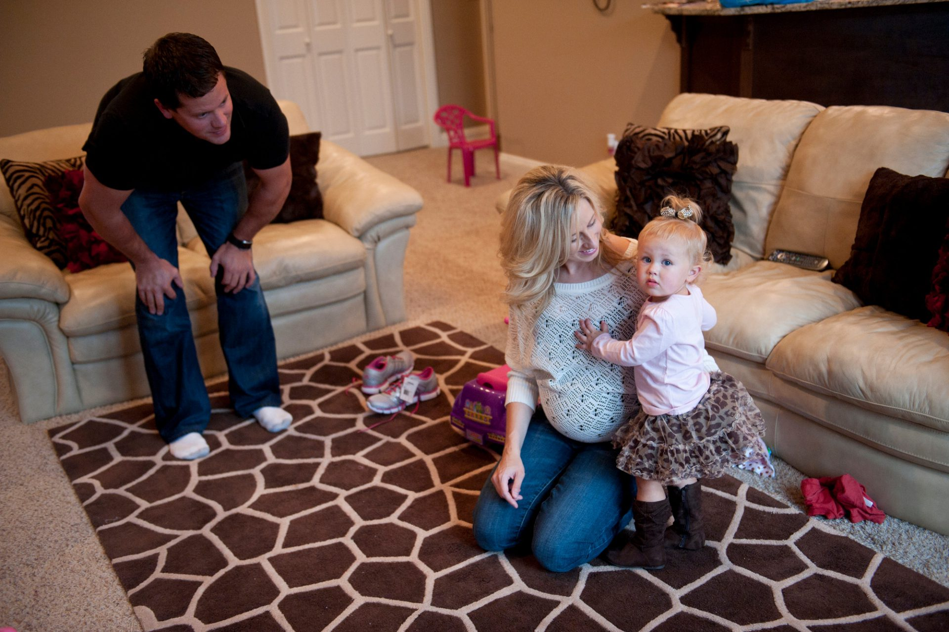 Photo: A young couple play with their little girl in Lincoln, Nebraska.