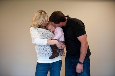 Photo: A young couple hold their little girl in Lincoln, Nebraska.