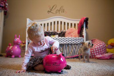 Photo: A little girl puts money in a piggy bank in Lincoln, Nebraska.