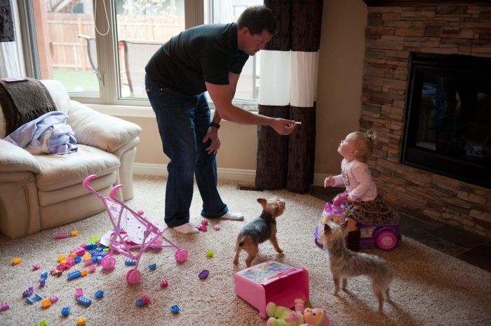 Photo: A father gives his little girl a snack in Lincoln, Nebraska.