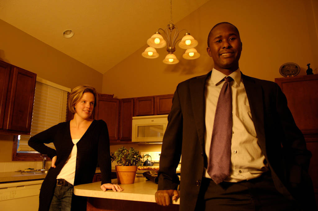 Photo: A husband and wife in the kitchen of their suburban home in Lincoln, Nebraska.