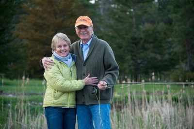 Photo: A couple at their fishing pond.
