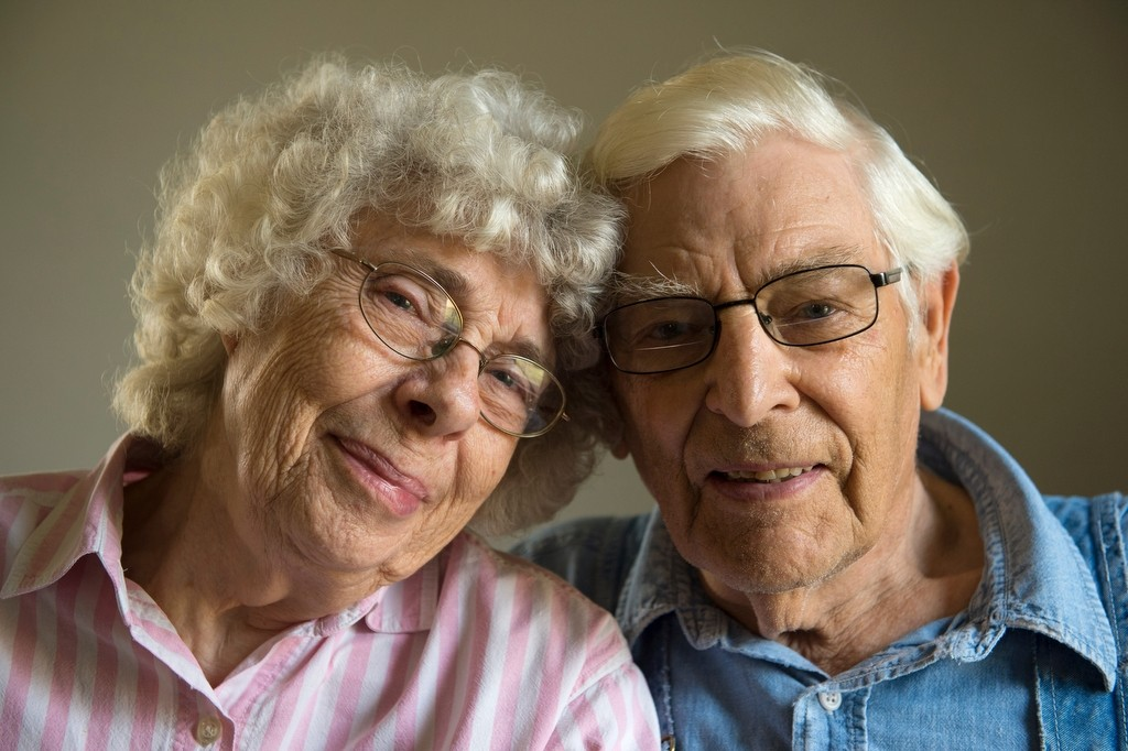 Photo: An older couple pose for a portrait.