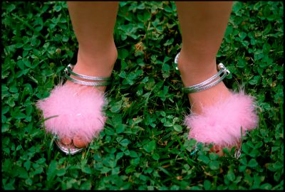 Photo: A girl wears fancy slippers.