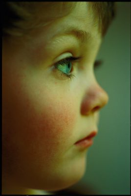 Photo: Profile portrait of a young boy.