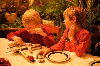 Photo: Two boys play with toys at a table.