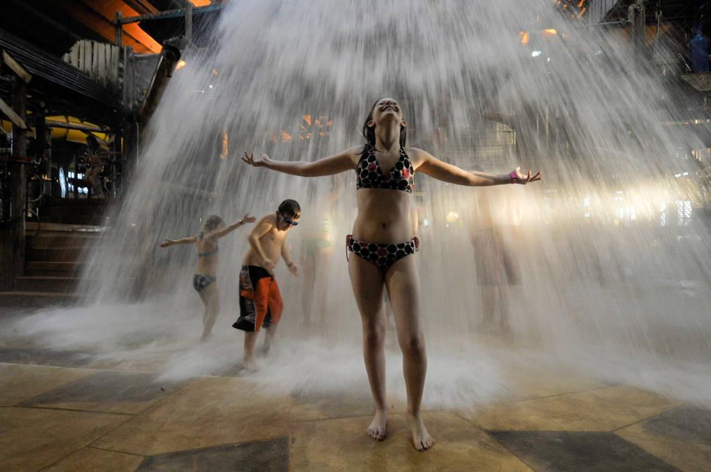Photo: Ellen Sartore enjoys a splash at the Great Wolf Lodge indoor water park in Kansas City, Kansas.