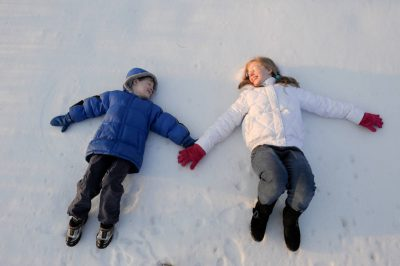 Photo: A brother and sister play in the snow in Nebraska.