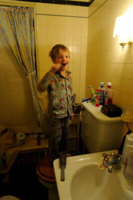 Photo: A five year-old boy brushes his teeth at bedtime.