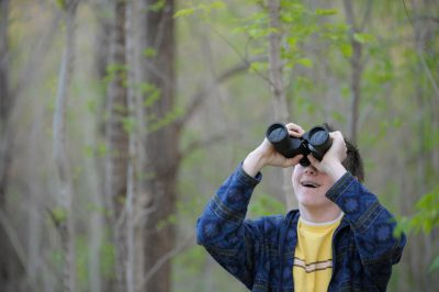 Photo: A young man bird watching along the Steamboat Trace trail between Nebraska City and Peru, Nebraska.