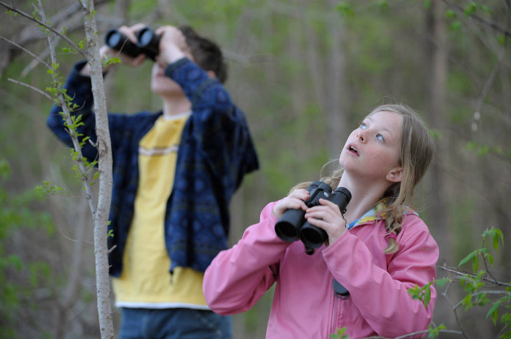 Photo: A young man and girl bird watching along the Steamboat Trace trail between Nebraska City and Peru, Nebraska.