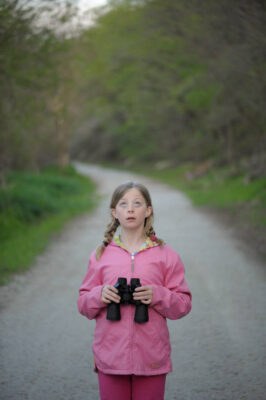Photo: A young girl bird watching along the Steamboat Trace trail between Peru and Nebraska City, Nebraska.