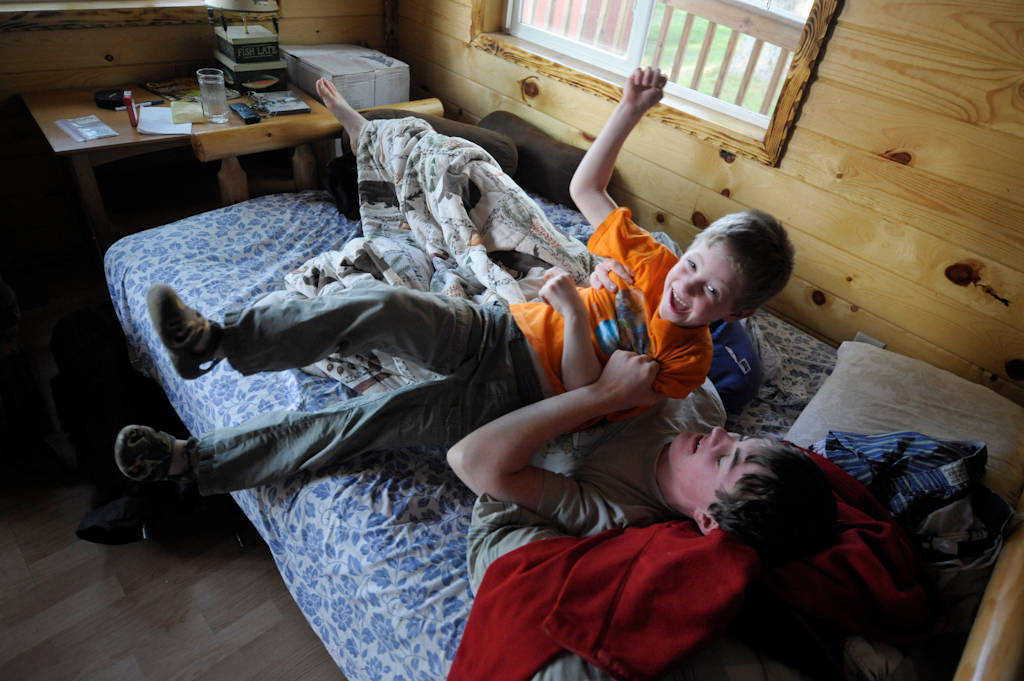 Photo: Two brothers wrestling at a cabin in Leech Lake, Minnesota.