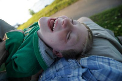 Photo: A young boy laughing while on vacation at Leech Lake, Minnesota.