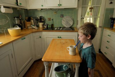 Photo: A young boy drinking from a mug with a straw at his home in Lincoln, Nebraska.