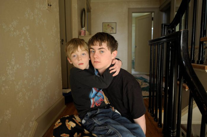 Photo: A young boy sits on his older brothers lap at their home in Lincoln, Nebraska.