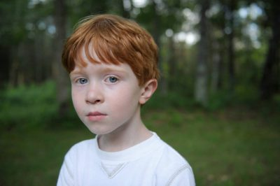 Photo: A young boy poses for a photograph while on vacation in Crosslake, Minnesota.