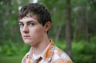 Photo: A teenage boy poses for a photograph while on vacation in Crosslake, Minnesota.