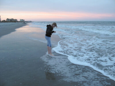 Photo: A girl on Cocoa Beach, Florida.