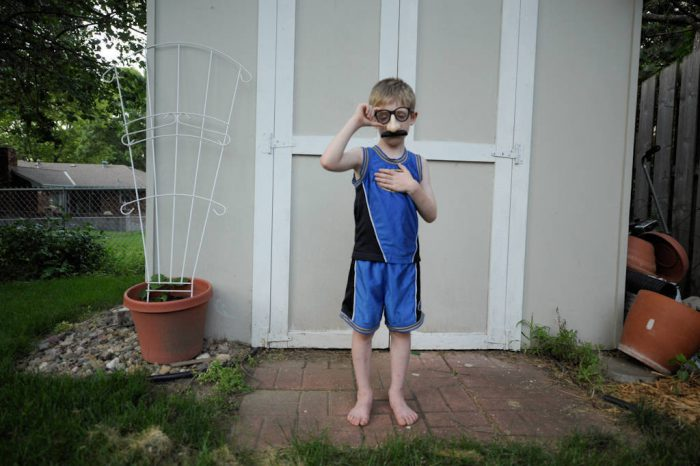 Photo: A six year-old boy sports a disguise of a fake nose, mustache, and glasses.