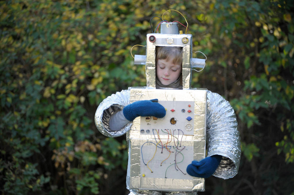 photo a seven year old boy in his robot halloween costume made by his mother