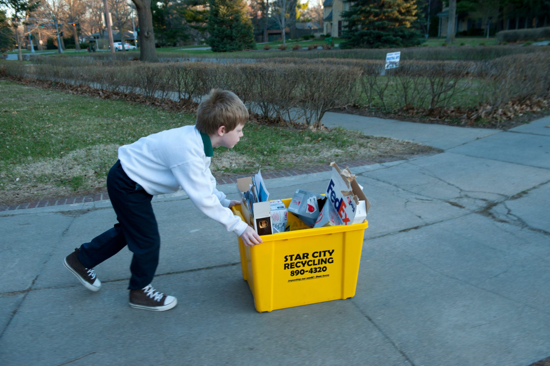 Photo: A young boy recycles.