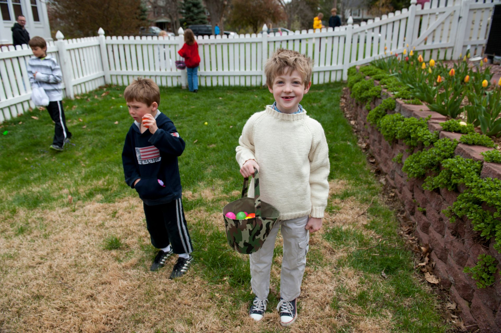 Photo: Young children participate in an Easter egg hunt.