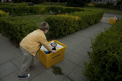 Photo: A young boy helps recycle.