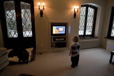 Photo: A toddler watches television.