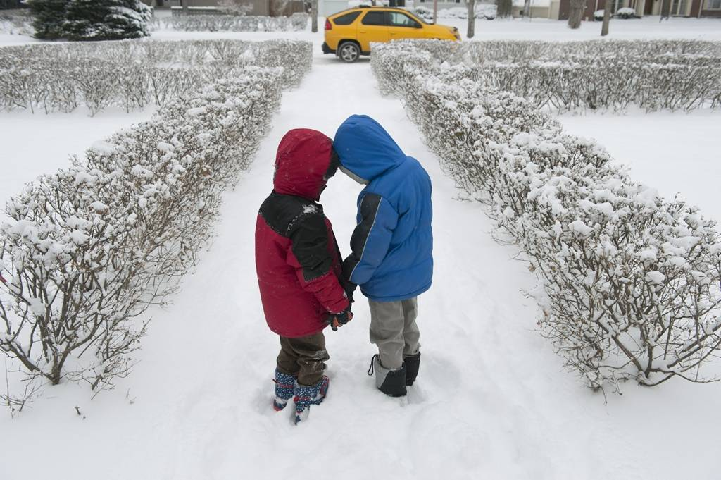 Photo: Two boys play in the snow.
