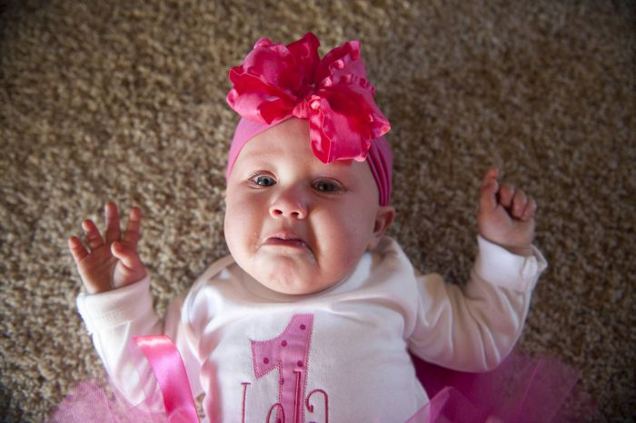 Photo: A baby girl pitifully cries.