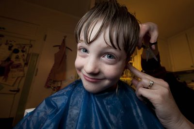 Photo: A young boy gets a haircut.