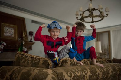Photo: Two brothers play as super heros.