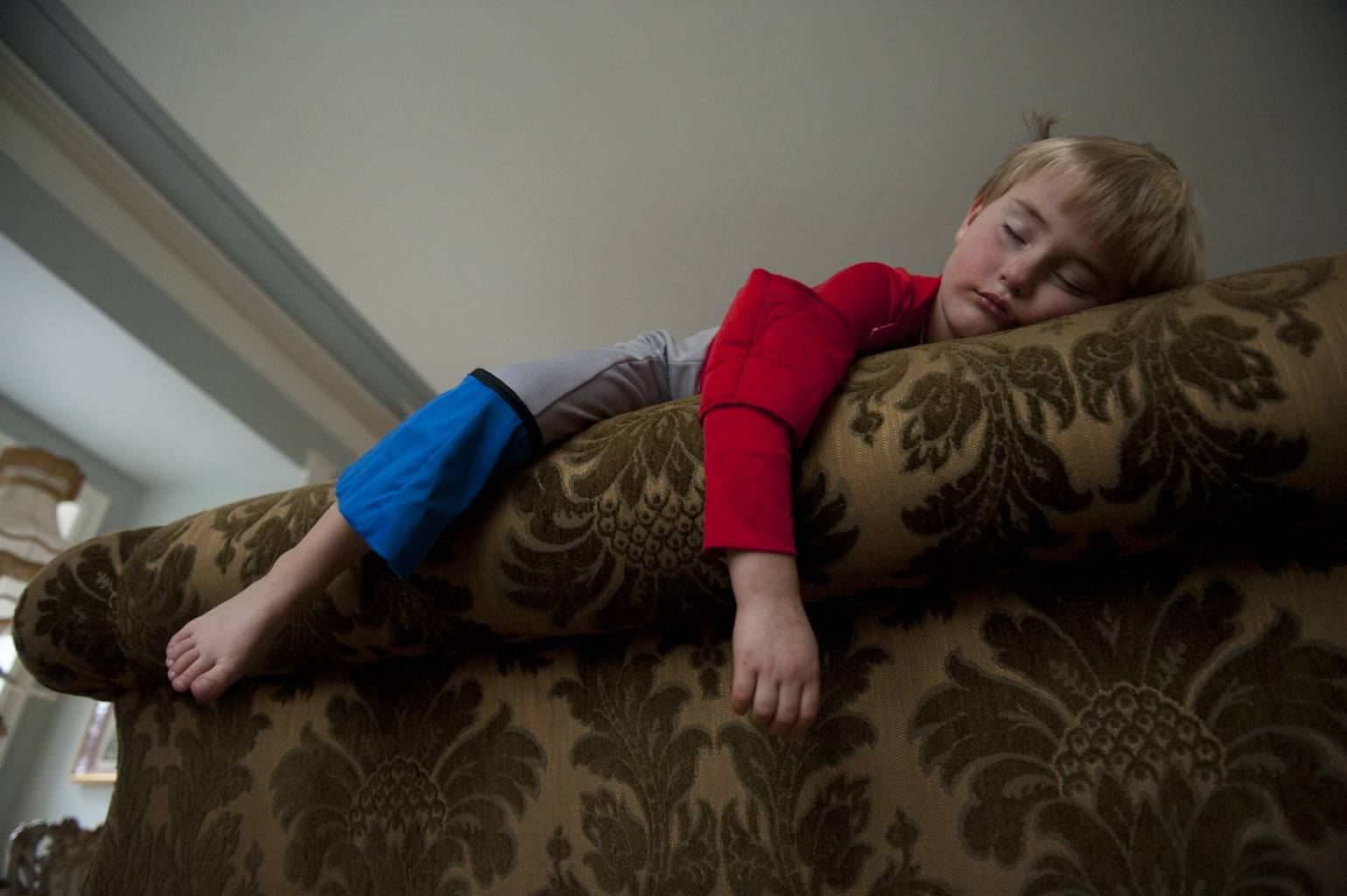 Photo: Being a super hero is exhausting for a little boy.